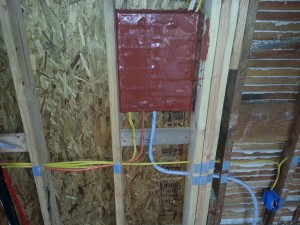 Panel is covered with Fire Pads because the wall is fire rated wall facing the garage.